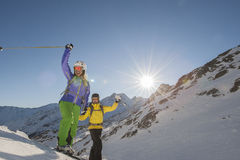Downhill skiing - alpine ski. Two skiiers beckon and have fun Royalty Free Stock Photography