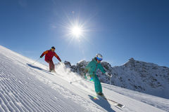 Downhill skiing in behind the sun. Perfect skiing weather in the winterland Stock Images