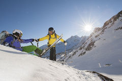 Downhill skiing - ski guide - ski rescue. A ski guide help his Student by skiing Stock Photography