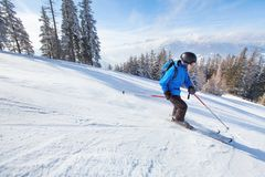 Downhill skiing. Skier going fast down the mountain, winter sport background stock image