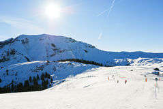 Downhill skiing on snow slopes in sunny day Royalty Free Stock Photography