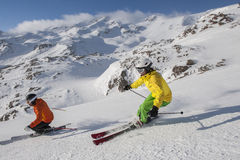 Downhill skiing - winter skiing. Alpine skiing in the mountains Stock Photos