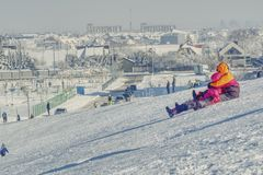 Downhill sledding provides a lot of excitement royalty free stock images