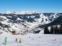 Downhill slope and apres ski mountain hut with restaurant terrace in Saalbach Hinterglemm Leogang winter resort, Tirol Stock Images