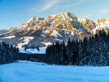 Downhill slope in Saalbach Hinterglemm Leogang winter resort, Tirol, Austria, Europe. Sunny morning with clear sky and Royalty Free Stock Images
