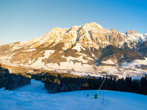 Downhill slope in Saalbach Hinterglemm Leogang winter resort, Tirol, Austria, Europe. Sunny morning with clear sky and Stock Photography