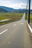 Downhill straight roadway Stock Photos