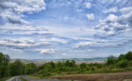 Downhill to Alba Iulia. Sky ofer the city of Alba-Iulia Royalty Free Stock Photos