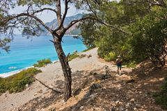 Downhill to sand dunes of Agios Pavlos beach from e4 trail between Loutro and Agia Roumeli at south-west od Crete island stock image