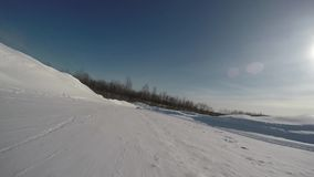 Downhill tubing gopro video. Downhill tubing on a sunny winter day gopro video stock video footage
