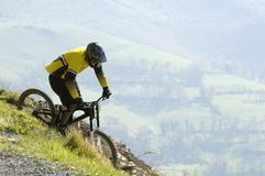 Downhiller. Downhill mountain bike rider ( with copy space royalty free stock images