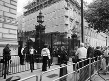 Downing Street in London black and white. LONDON, UK - JUNE 09, 2017: People waiting for Theresa May in front of 10 Downing Street on the day following the Royalty Free Stock Photos