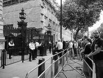 Downing Street in London black and white. LONDON, UK - JUNE 09, 2017: People waiting for Theresa May in front of 10 Downing Street on the day following the Stock Photo