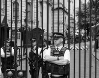 Downing Street in London black and white. LONDON, UK - JUNE 09, 2017: Police and press waiting for Theresa May in front of 10 Downing Street on the day following Royalty Free Stock Photos