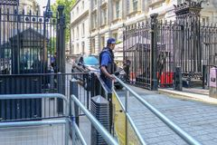 Black steel gates protecting the entrace to Downing Street, with royalty free stock image