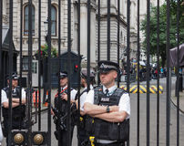 Downing Street in London. LONDON, UK - JUNE 09, 2017: Police and press waiting for Theresa May in front of 10 Downing Street on the day following the general Stock Photos