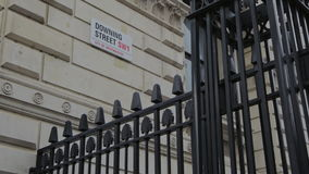 Downing street road sign, London, England, uk stock footage