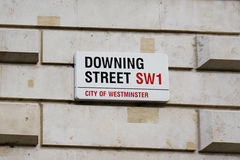 Downing Street Sign Attached to Wall by the Gates into Downing Street in Westminster, London. Royalty Free Stock Image