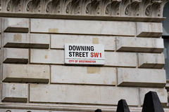 Downing Street Sign Attached to Wall by the Gates into Downing Street in Westminster, London. Stock Images
