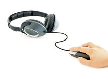 Download music. Music headphones connected to computer mouse with male hand Royalty Free Stock Image