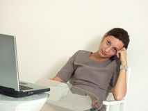 Downloading... Working Woman bored waiting for a slow download from the web on her notebook PC Stock Photography