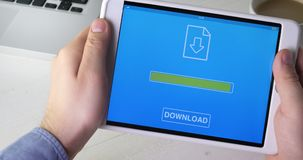 Downloading file to the digital tablet. Stock footage stock video