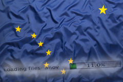 Downloading files on a computer, Alaska flag royalty free stock image