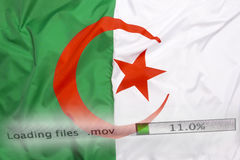 Downloading files on a computer, Algeria flag stock photography