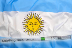 Downloading files on a computer, Argentina flag royalty free stock image