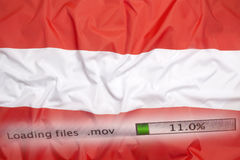 Downloading files on a computer, Austria flag royalty free stock image