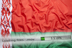 Downloading files on a computer, Belarus flag stock photos