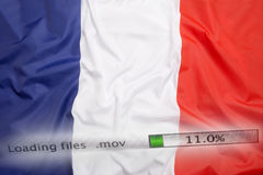 Downloading files on a computer, France flag stock photography