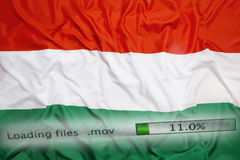 Downloading files on a computer, Hungary flag royalty free stock photography