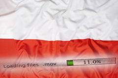 Downloading files on a computer, Poland flag Royalty Free Stock Photos