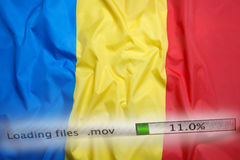 Downloading files on a computer, Romania flag. Downloading files on a computer with Romania flag Stock Images