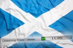 Downloading files on a computer, Scotland flag. Downloading files on a computer with Scotland flag stock photos