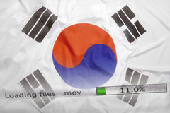 Downloading files on a computer, South Korea flag. Downloading files on a computer with South Korea flag royalty free stock photo