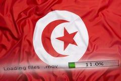 Downloading files on a computer, Tunisia flag royalty free stock photos