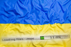 Downloading files on a computer, Ukraine flag royalty free stock image