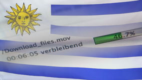 Downloading files on a computer, Uruguay flag. Downloading files on a computer with Uruguay flag stock video footage
