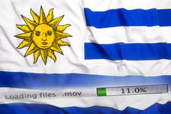 Downloading files on a computer, Uruguay flag royalty free stock photo