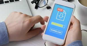 Downloading pdf file to the smartphone. Stock footage stock video footage