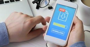 Downloadingpdf-Datei zum Smartphone stock video footage