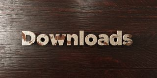 Downloads - grungy wooden headline on Maple  - 3D rendered royalty free stock image. This image can be used for an online website banner ad or a print postcard Royalty Free Stock Image