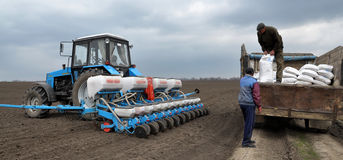 Downloads tractor sowing fertilizers_6 Royalty Free Stock Image