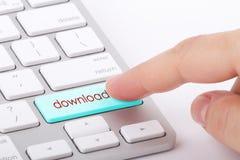 Downloadwort auf Tastatur Stockfoto