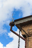 Downpipe old wooden houses with carved decorative elements. Stock Photo