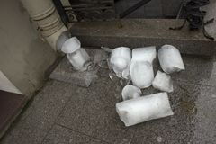 The downpipe and pieces of ice royalty free stock photography
