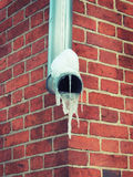 The downpipe was covered with ice. On the drainpipe of the building in the winter and lots of ice Stock Photo