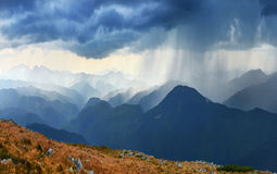 Downpour. Heavy downpour in spring mountains Stock Photo